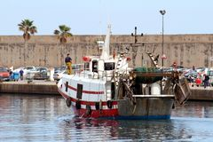 Trawlers fishing boats going to dock after work. Royalty Free Stock Photos
