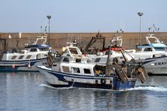 Trawlers fishing boats going to dock after work. Royalty Free Stock Photography
