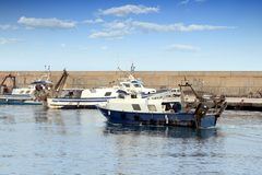 Trawlers fishing boats going to dock after work. Stock Images