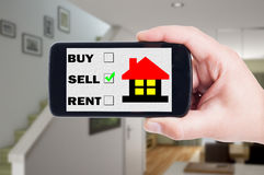 Sell a house using mobile phone, cellphone or smartphone concept Stock Images