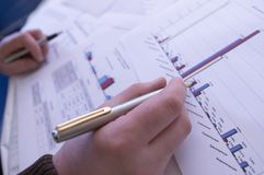 Sell Rates. Hand with a pen, inspecting bisiness diagramm stock photo