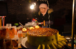 Sell sweet osmanthus cake woman. In xi 'an street night market sell osmanthus cake women on both sides of the light stock image