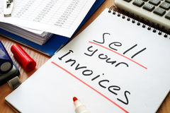 Sell your invoices. Note with sign sell your invoices Royalty Free Stock Photography