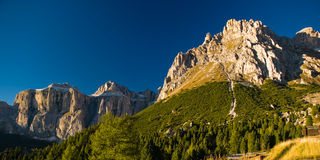 Sella mountain range. In dolomite alps on late afternoon with deep blue sky Stock Photo
