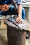 Sellado de la placa de identificación del martillo imagen de archivo libre de regalías