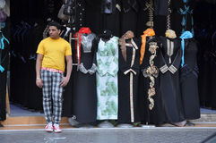 A seller of abaya in the market of Sharjah Stock Images