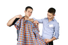 Seller advises clothes Royalty Free Stock Images
