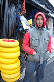 Seller of agricultural equipment on the local market Stock Photo