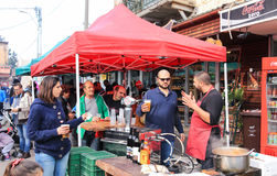 Seller of alcoholic beverages pours beer for the buyer. Haifa, Israel - December 17, 2016 : The seller of alcoholic beverages pours beer for the buyer and Royalty Free Stock Image