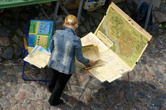The Seller of antique maps Stock Photo