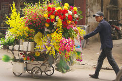 Seller of artificial flowers Stock Image