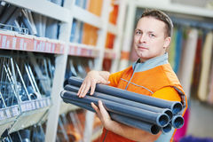 Seller assistant in shop. Happy female seller or shop assistant portrait in hardware supermarket store stock photography