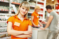 Seller assistant in shop. Positive female seller or shop assistant portrait  in hardware supermarket store Stock Photos