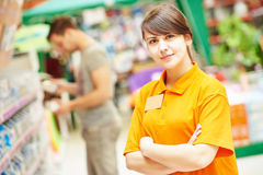 Seller assistant in shop. Positive female seller or shop assistant portrait  in hardware supermarket store Royalty Free Stock Photos