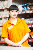 Seller assistant in shop. Positive female seller or shop assistant portrait  in hardware supermarket store Stock Image