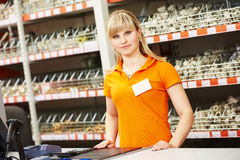 Seller assistant in shop. Positive female seller or shop assistant portrait  in hardware supermarket store Royalty Free Stock Image