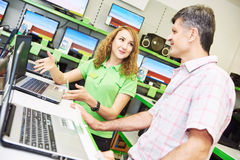 Seller assistant woman help purchaser choosing laptop Stock Image