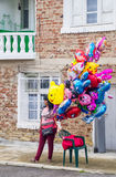 The seller of balloons in the village of Bulgari, Bulgaria Royalty Free Stock Image