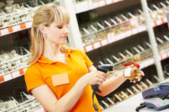 Seller with barcode scanner in shop Stock Image