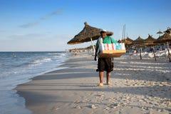 Seller on beach Stock Image