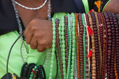 The seller of beads. Indian travel. Jewelery from stones, souvenirs and gifts, a man with dark skin, hold in hands, show goods, colorful semiprecious stones stock photography
