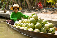 Seller on Boat at Damnoen Saduak Floating Market Royalty Free Stock Image