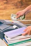 Seller at bookstore using cash register Stock Photos