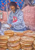 Seller of bread on the market in Morocco. Souk El Had of Agadir. In Morocco, bread can be bought not only in bakeries, fresh and tasty bread sold right on the stock photos