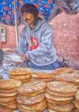 Seller of bread on the market in Morocco. Souk El Had of Agadir. stock photos