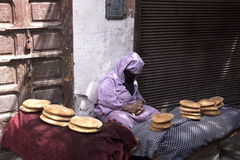 Seller of bread in the souq in Marrakech Stock Images