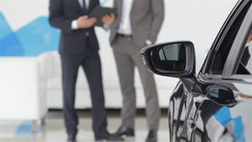 The seller and the buyer in the auto show stock footage
