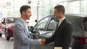 Men have concluded a good deal of buying a car stock photography
