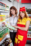 The seller and the buyer in grocery shop Stock Photography