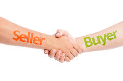 Seller and Buyer shaking hands Stock Images
