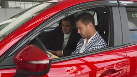 The seller and the buyer are sitting inside the new car stock photos