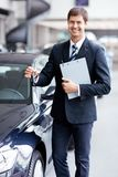 Seller with car keys Royalty Free Stock Images