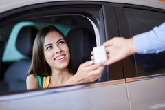 Transfer of keys from the new car. Buying a car in showroom Stock Photography