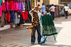 Seller of clothes Stock Photos