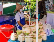 The seller of coconuts Royalty Free Stock Images