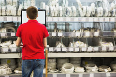 Seller at the computer for inventory. Of products in hardware store Stock Images