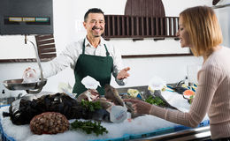 Seller and customer in fishery Royalty Free Stock Photos