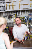 Seller and customer in household store Royalty Free Stock Photos