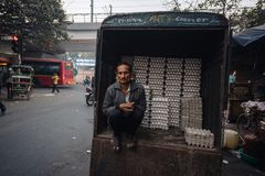 Seller of eggs in the early morning in Delhi. India. 27.11.2017. Seller of eggs in the early morning in Delhi. India. 27.11.2017 Stock Photography