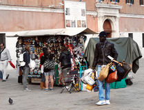 Seller fake branded bags selling bags on the Venetian embankment Stock Image