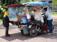 Seller fast food on a cart Royalty Free Stock Image
