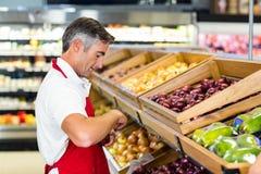 Seller filling vegetables box Stock Image