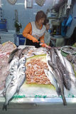 Seller at fish market Royalty Free Stock Photos