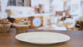 The seller gives muffin to the visitor, a close-up stock footage