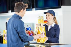 Seller Giving Popcorn And Drink To Man At Royalty Free Stock Photography