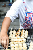 Seller grill pork meatball toast on the grille Stock Photography
